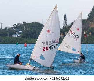 Itajai, Santa Catarina / Brazil - 08 06 2018: Two Laser sailboats in opposite tacks head for a mark during a practice regatta