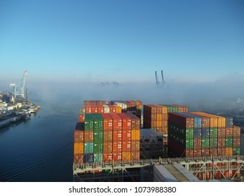 Itajai, Santa Catarina, Brazil - 2018 04 21 - A large ship faces fog on its way to the berth