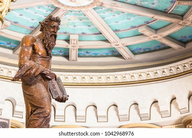 Itajai, Santa Catarina, Brazil - February 22th, 2018: A wooden statue of Moses with the law tables inside the Matriz Church Igreja do Santissimo Sacramento in Itajai, Santa Catarina, Brazil.