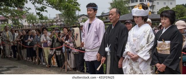 ITAKO, IBARAKI, JAPAN - JUNE 4TH 2016. Japanese bride in traditional costume during the annual Suigo Itako Iris Flower Festival.