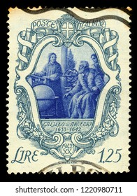 ITALIA - CIRCA 1942: a postage stamp printed in Italia showing Galileo Galilei with his disciples in Arcetri, 3 centenary of the death of Galileo Galilei, circa 1942