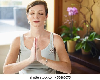 italian 6 months pregnant woman doing yoga exercise at home. Horizontal shape, head and shoulders, front view