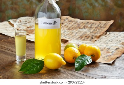 Italian alcoholic beverage, Limoncello on wooden table