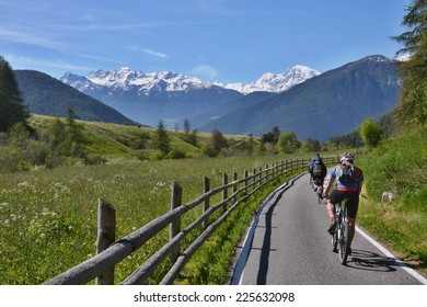 Italian Alps-unknown cyclists on the bicycle path to Laudes