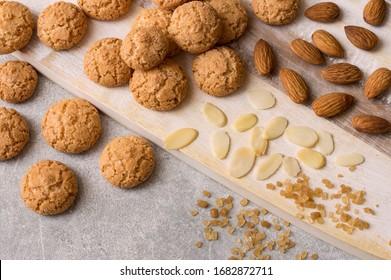 Italian amaretti biscuits. Crunchy almond cookies with sliced and whole nuts and large crystals of brown sugar.