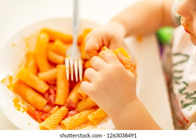 Italian Amatriciana Pasta with tomato sauce and smoked bacon served as first dish for children. Italian cuisine concept. Selective focus.