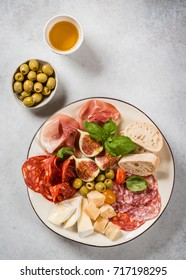 Italian antipasti plate with ham, salami, cheeses, olives and figs