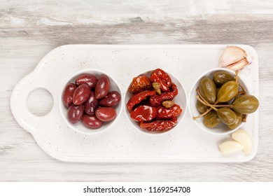 Italian appetizer from above. Capers, dry tomatoes, garlic and olives.