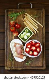 Italian appetizer antipasti made dish - ham, cheese, peppers