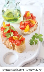 Italian appetizer. Bruschetta with tomatoes and olive oil on light background