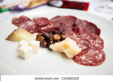 Italian appetizer in a wedding party:deer and wild boar salami, venison ham, seasoned Sardinian pecorino cheese, feta cheese and olives.