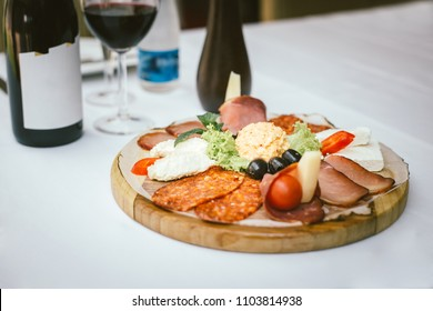 italian appetizer wine snacks set cheese-variety mediterranean olives pickles prosciutto