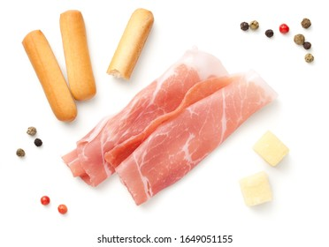 Italian appetizers, prosciutto slices, mini grissini breadsticks, hard cheese pieces isolated on white background. Top view, flat lay