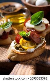 Italian appetizers - various bruschettas, vertical