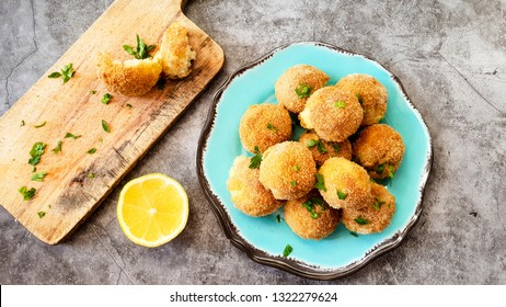 Italian arancini. Home made rice balls with mozzarella cheese,parsley ,lemon and parmesan cheese.