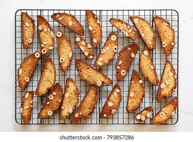Italian biscotti or cantuccini cookie on a rack on white background, horizontal