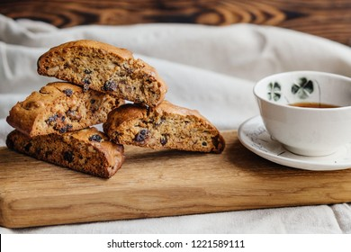 Italian biscotti cookies with a cup of black tea on a light tablecloth. cozy photo