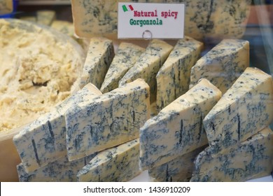Italian blue cheese   . Gorgonzola is a Italian blue or moldy cheese.