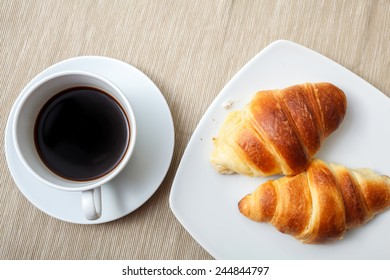 Italian breakfast with croissant and coffee