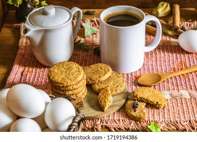 Italian breakfast with wholemeal biscuits and coffee prepared on a wooden table with rustic background