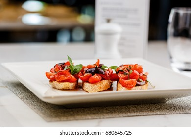 Italian bruschetta with chopped tomatoes, basil and olive