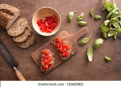 Italian bruschetta on wooden table overview