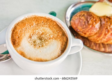 Italian cappuccino and croissant with copy space