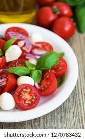 Italian caprese salad with cherry tomatoes and mozzarella