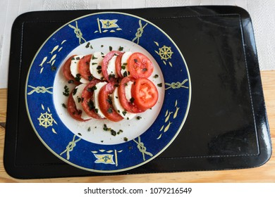 Italian caprese salad with tomatoes and mozzarella on a plate