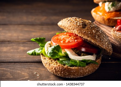 Italian Caprese sandwiches with fresh tomatoes, mozzarella cheese and lamb's lettuce, multigrain bun. Healthy food concept with copy space