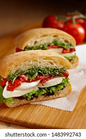 Italian Caprese sandwiches with fresh tomatoes, mozzarella cheese and basil .Tasty gourmet meat and cheese sandwiches with mozzarella ball and olive oil. Includes copy space.