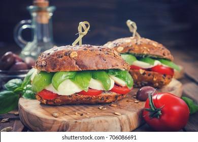 Italian Caprese sandwiches with fresh tomatoes, mozzarella cheese and basil
