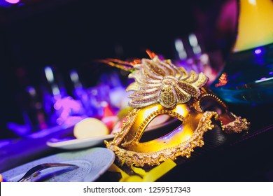 Italian carnival venetian golden mask. Mysterious event, party.