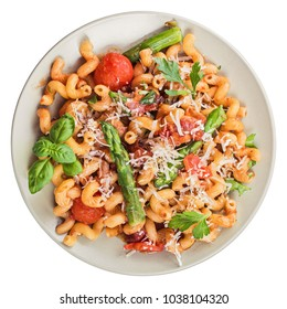 Italian cavatappi pasta with asparagus and tomatoes, top view. Isolated