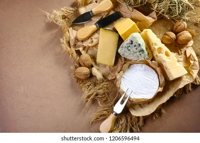 Italian cheese assorted, cheese with blue mildew, Camembert or brie cheese circle, Cheese Serving Knife. top view, copy space.