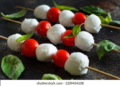 Italian cheese mozzarella with tomatoes and basil - caprese skewers