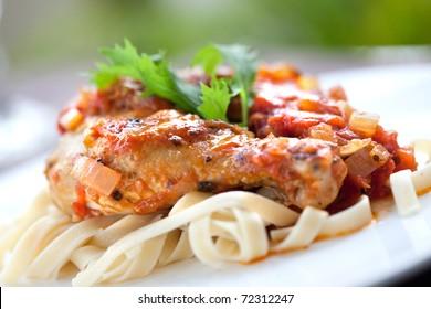 Italian chicken cacciatore served with pasta