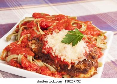 Italian chicken Parmesan or parmigiana in spaghetti souse