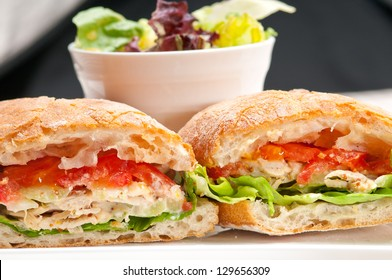 italian ciabatta panini sandwich with chicken and tomato