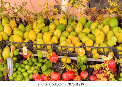 italian citrons at the market with lemons and pomegranate, sicily, italy