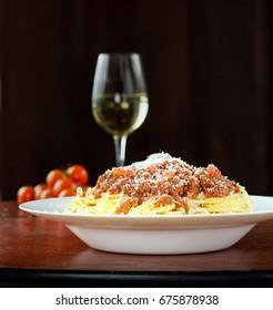 Italian classic Spaghetti Alla Bolognaise in natural window light on wooden board