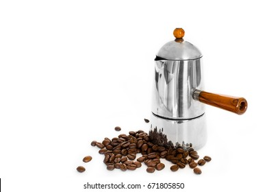 Italian coffee maker and coffee beans on white background