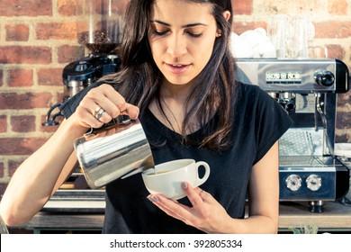 Italian coffee shop cafe Brazilian hot drink waitress barista female cakes friendly smile