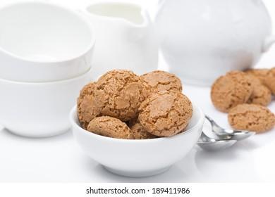 Italian cookies amaretti and crockery for teatime, close-up