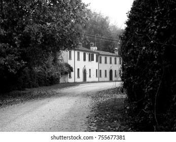 Italian countryside. Houses on the roadside. Black and white photo.