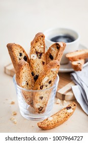 Italian cranberry almond biscotti  and cup of coffee on background