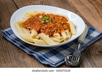 Italian cuisine - pasta penne with tomato bolognese sauce.