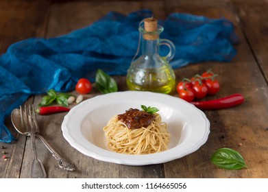 Italian cuisine - pasta with various sauces, basil, olive oil and cherry, Rustic composition, Delicious dinner