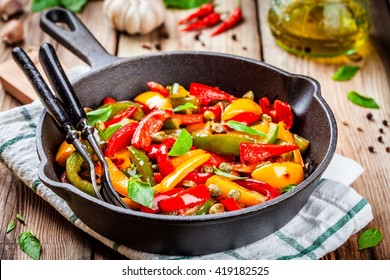 Italian cuisine, peperonata: roasted bell pepper with capers and basil in a pan