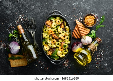 Italian cuisine. Ravioli with onions and mustard. Top view. Free space for your text. Rustic style.